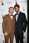 LOS ANGELES - SEP 21:  Jesse Tyler Ferguson, Justin Mikita arrives at the Primetime Emmys Performers