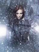 picture of redheaded  - Fashion shoot of young attractive woman in blowing silk over the snowy background - JPG