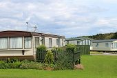 image of trailer park  - Scenic view of modern trailers in caravan park - JPG