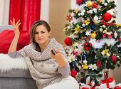Frustrated Woman With Tv Remote Control Near Christmas Tree