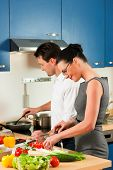 stock photo of crudites  - Man and woman in the kitchen  - JPG