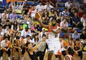 KUALA LUMPUR - OCTOBER 28: Dragons' Moala Tautaa #33 scores an easy basket against the Firehorse tea