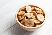 stock photo of fibrin  - dried banana chips in bowl - JPG