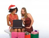 Two Women: Christmas Online Shopping Using Laptop