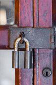 Rusty Master Key On Wood Door