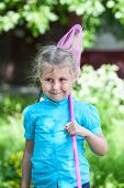 Happy Child Standing With Butterfly Net At Summer Day