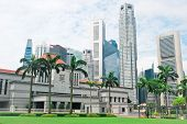 picture of significant  - Singapore Parliament builading in front of Singapore downtown - JPG