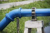 foto of mortar-joint  - blue water supply pipeline was joint and hold with pedestal cement - JPG