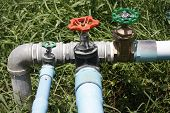 stock photo of valves  - water valve with separate supply pipes with brass joint of metal pipeline with Plumbing PVC - JPG