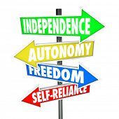 The words Independence, Autonomy, Freedom and Self-Reliance on four road sign arrows pointing and di