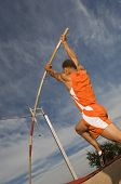 picture of pole-vault  - Low angle view of a male athlete performing a pole vault against the sky - JPG