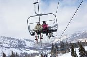 Low angle view of a couple in skies sitting on ski lift
