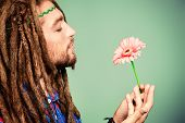 pic of hippy  - Portrait of a hippie young man with a flower - JPG