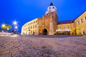 The Cracow gate of old town in Lublin at night, Poland
