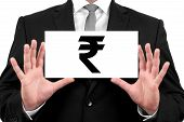 Indian rupee symbol. Businessman shows business card