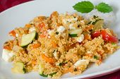 Couscous with vegetables with yogurt sauce