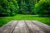 Wooden Table With Green Nature Background