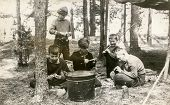 PLOCICZNO, POLAND, CIRCA 1957 - vintage photo of group of scouts peeling potatoes during a summer ca