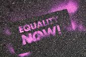 Chicago, Il - June 30: The phrase Equality Now is spray painted on the streets pavement during the 4