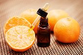 bottle of tangerine essential oil - beauty treatment