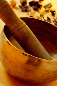 closeup of a tibetan singing bowl with its mallet