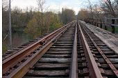 Rusting Railroad Tracks Going Over Bridge