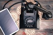 Tablet Lying Alongside A Retro Rotary Telephone