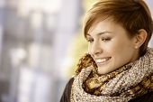 Profile portrait of attractive young woman with scarf