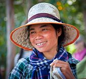 SIEM REAP, CAMBODIA - NOV 21, 2013: A smiling Cambodian woman  in the countryside of Siem Reap on No