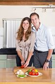 Work - Life Balance Concept: Couple cooking dinner together after work