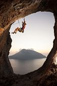 Climber falling of a cliff while lead climbing