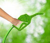 Hand holding green gasoline fuel