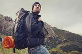 image of survival  - Adventure man hiking wilderness mountain with backpack - JPG