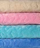 Close up of a folded duvets. For backgrounds.