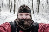 Hunter, winter in the woods