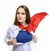 Young pretty woman opening her shirt like a superhero. Super girl over white background. Beauty saves the world.