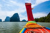 Limestone Karsts & A Long-tail Boat In Southern Thailand