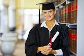 image of laws-of-attraction  - portrait of pretty female law school graduate in library - JPG