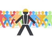 picture of people work  - A paper construction worker stands out from the multicolored crowd - JPG