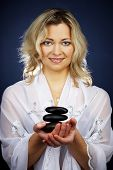 stock photo of taoism  - Woman of esoteric soul holding some symbols of taoism and alternative life styles - JPG