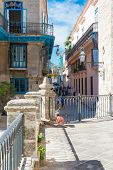 HAVANA,CUBA - JANUARY 20, 2014:Typical narrow street next to the Cathedral of Havana,very popular wi