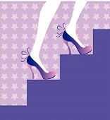 Female legs in violet shoes on a ladder