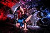 foto of break-dance  - Trendy young man dancer dancing in the old garage - JPG
