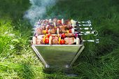 stock photo of brazier  - Grilled meat on sticks  - JPG
