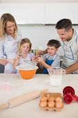 pic of flour sifter  - Parents looking at children baking cookies at kitchen counter - JPG