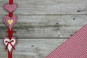 Red gingham (checkered) and muslin hearts border wood background