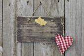 Wood sign with red and gold hearts hanging on door