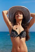 Sexy Bikini Woman In Hat Looking Happy On Blue Sea Background