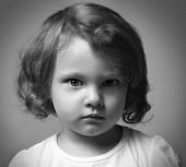 Angry Little Kid Girl Portrait Looking. Closeup