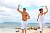 Couple Running With Sarong
